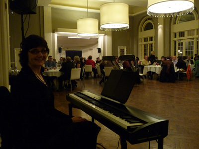 Live piano music for corporate holiday party at Calhoun Beach Club