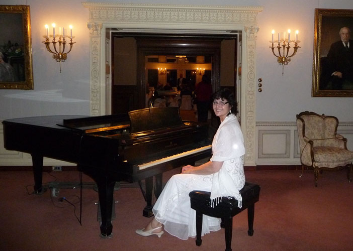 Elegant piano music for Board of Directors holiday Dinner at James J Hill House