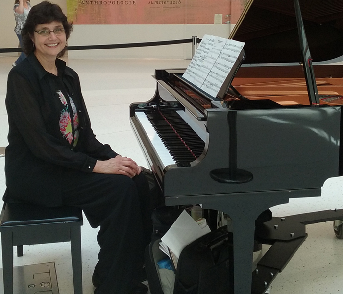 Sharon Planer performs piano music at Mall of America