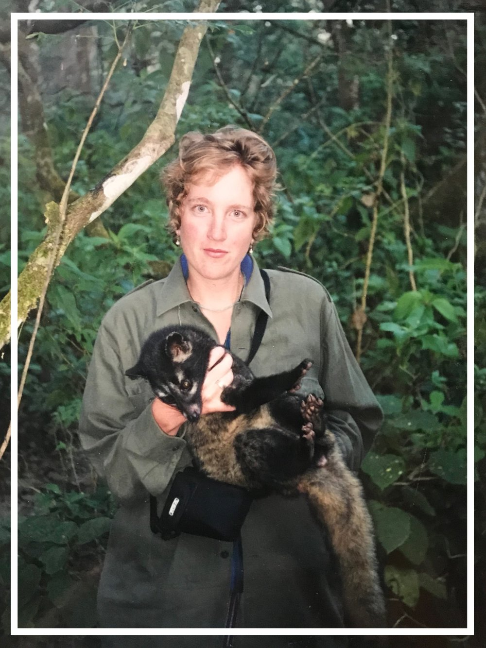 In the lowlands of Nepal, holding a marten.