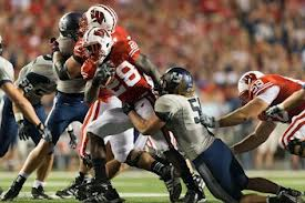 Aranda's defense held All-American Montee Ball to only 3.8 yards per carry on Sept 15, 2012.