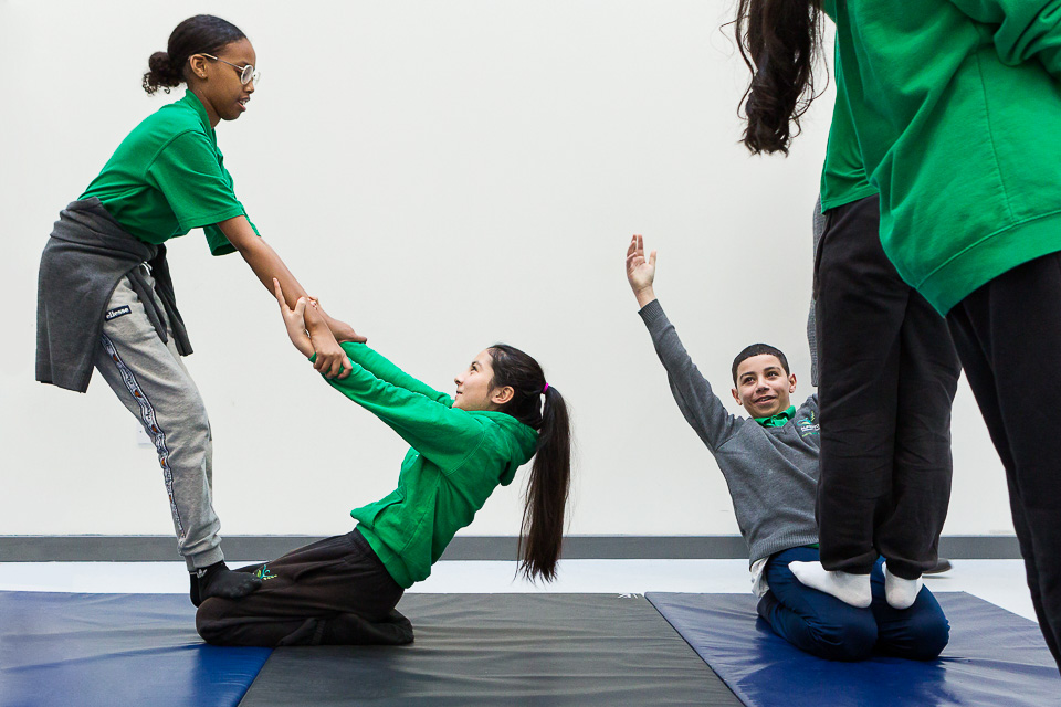 (above and below) A circus skills workshop for students ahead of Cirque du Soleil's  Totem