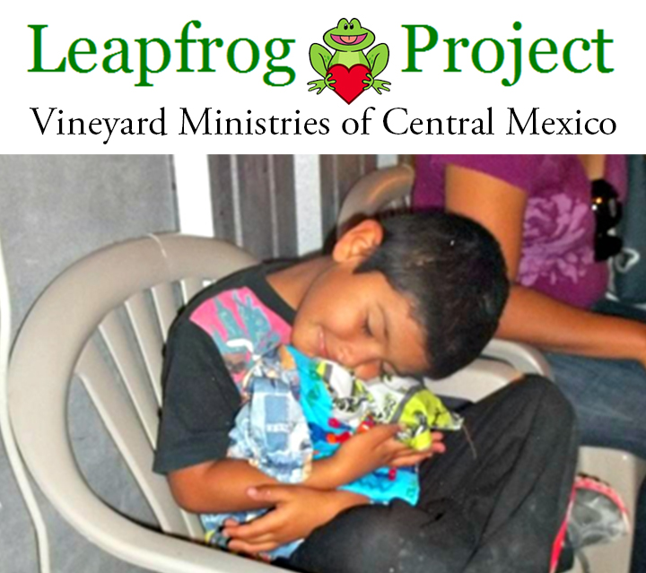 A boy hugs his new clothes from Project Leapfrog