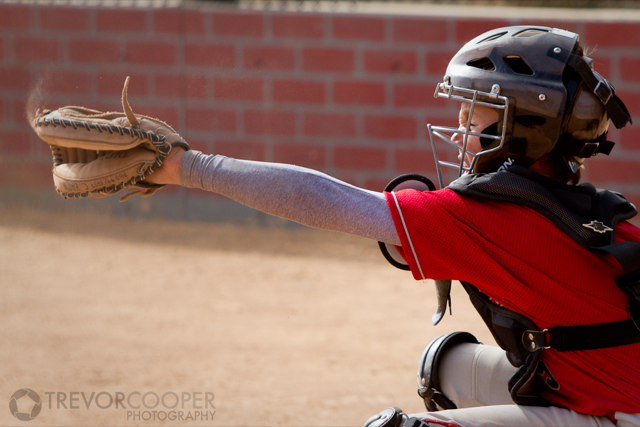 Encinitas EDGE Catcher squeezing pitch.