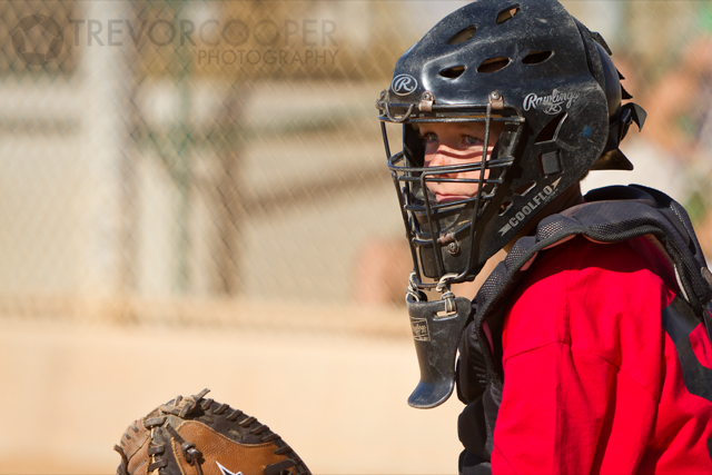 Encinitas EDGE Catcher takes signals from the dugout.