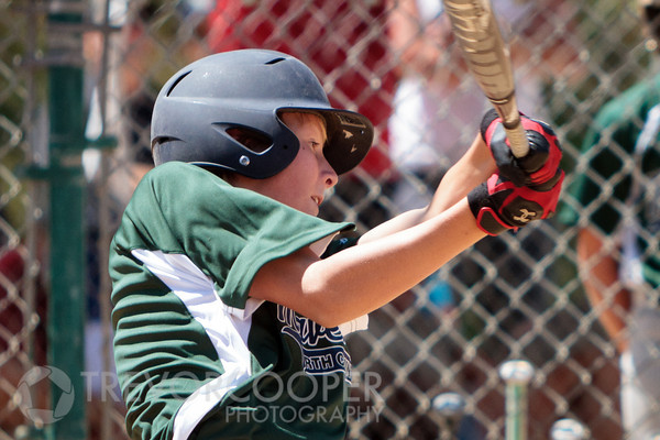 Junior Mavericks 7th Grade Batter follows through.