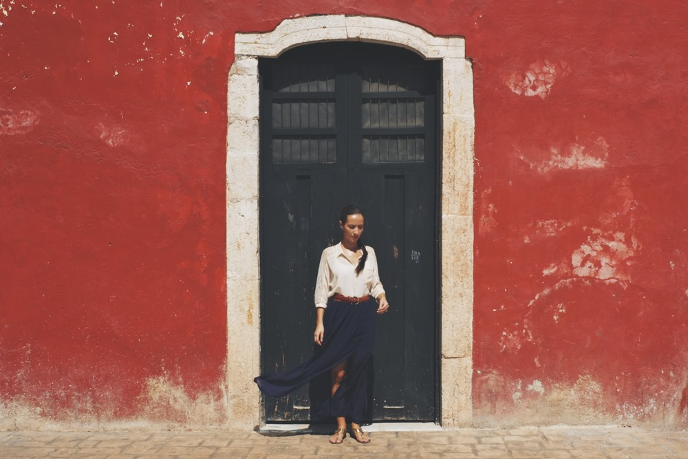 One of the many coloured walls and courtyards in Valladolid, Yucatan.