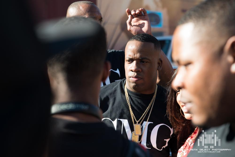 Random rap artist with random entourage.
