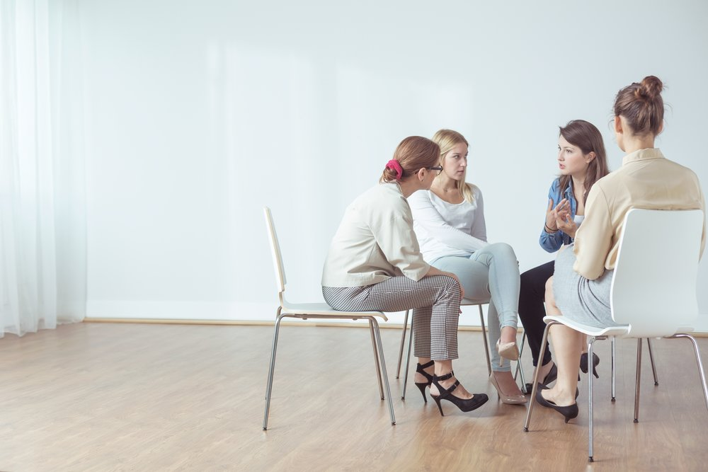 Group of women sitting in a circle talking