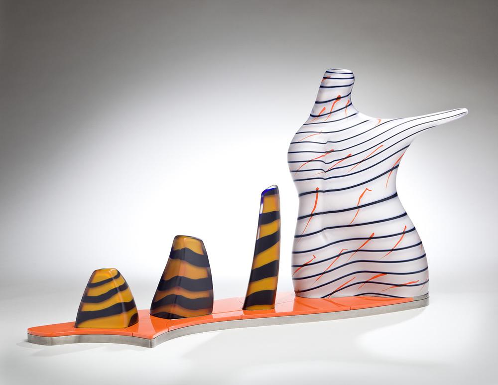 "Conformity    2011. Blown glass, Vitrolite, nickel-plated aluminum, glass details. 28½ x 29½ x 9½"""