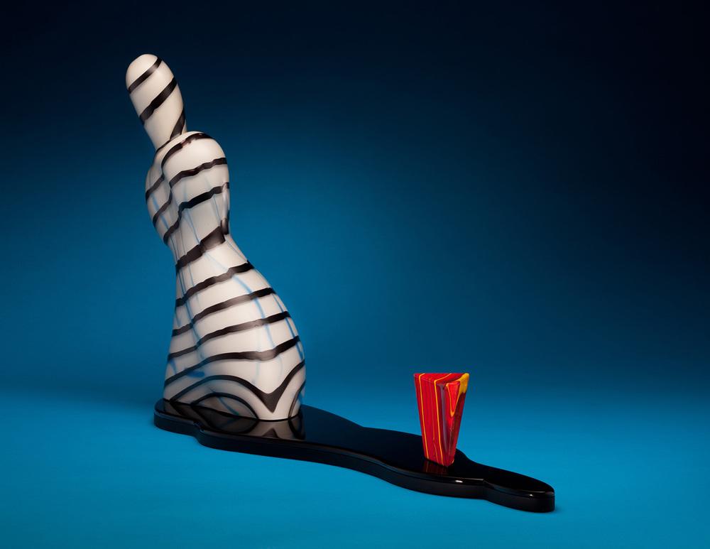 "Astonishment    2010. Blown glass, hot-worked glass, Vitrolite, and aluminum. 18 x 33½ x 8"""