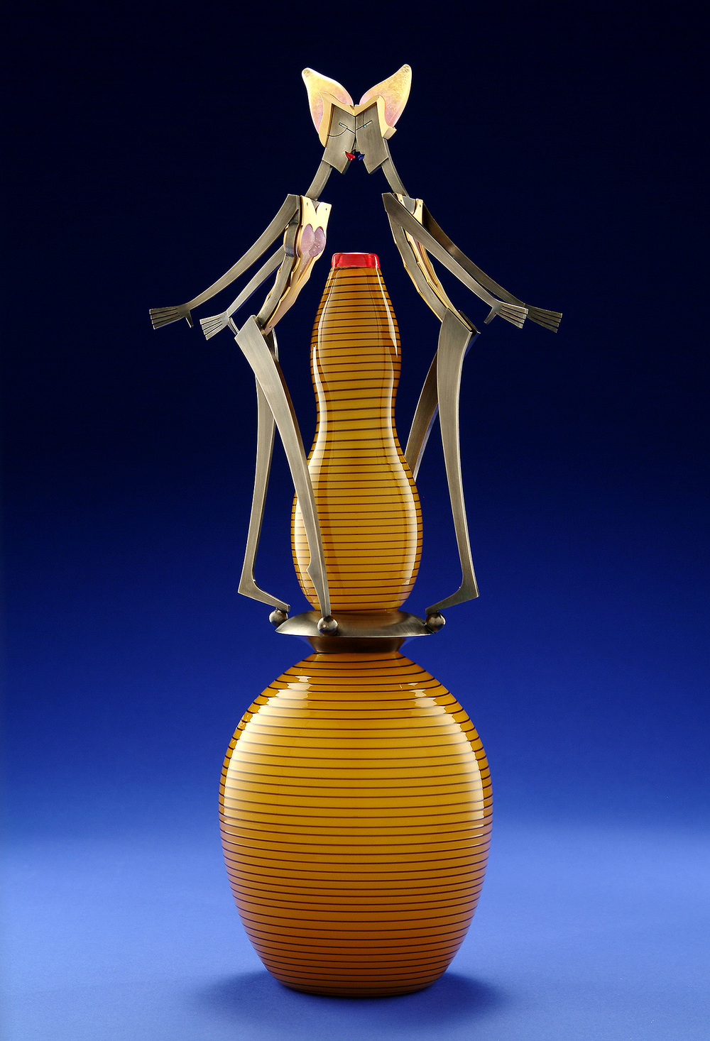 Kiss   2004. Blown glass, nickel and gold-plated bronze, pate de verre, Vitrolite. 22½ x 9½ x 6½""