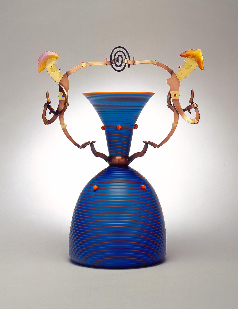 "Double Dimwits   2002. Blown glass, nickel and gold-plated bronze, pate de verre, Vitrolite. 22 x 15½ x 11"""