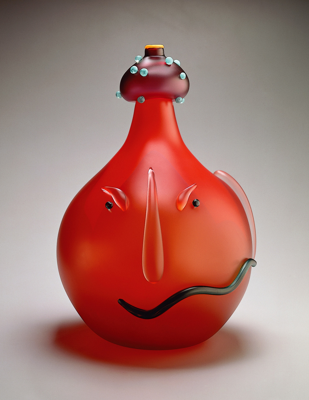 Chase   1994. Sandblasted and acid polished blown glass, glass details. 21 x 12½ x 12½""
