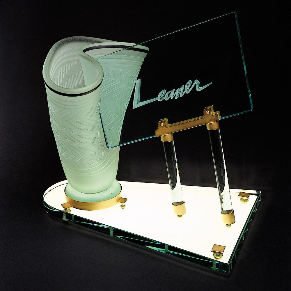 Leaner   1981. Blown glass, plate glass, gold plated brass. 16 x 16 x 9""