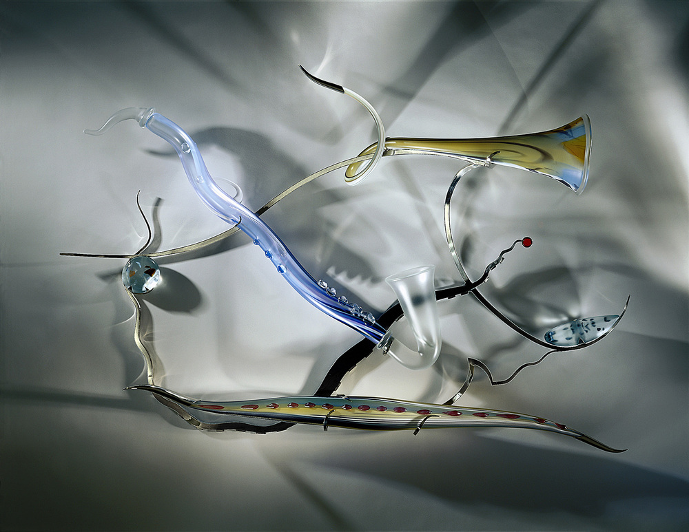 Ralph's New Blues   2001. Blown glass, glass details, nickel-plated bronze. 29½ x 54 x 9½""