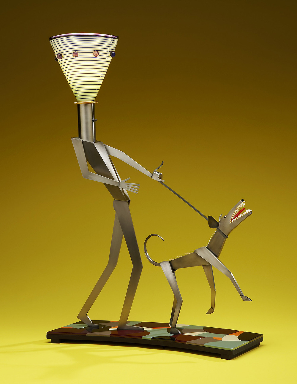 Man with His Dog   2005. Blown glass, nickel and gold-plated bronze, aluminum, Vitrolite and lampworked glass. 37 x 23 x 9""