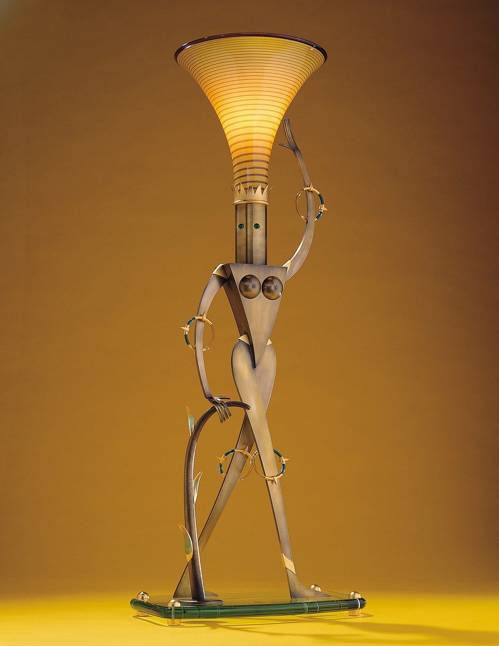 Statuesque   1999. Blown glass, brass, gold-plated brass, aluminum, plate glass, Vitrolite and lampworked glass. 42 x 17 x 11""