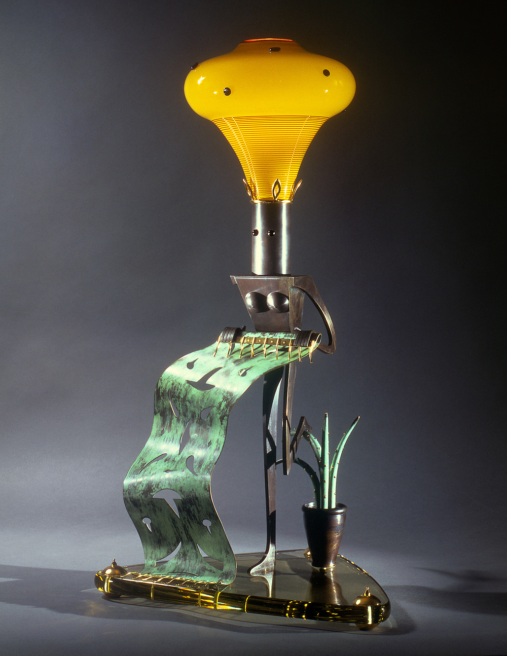 Nude with a Green Rug   1995. Blown glass, bronze, gold-plated bronze, plate glass, and lampworked glass. 34½ x 18 x 15""