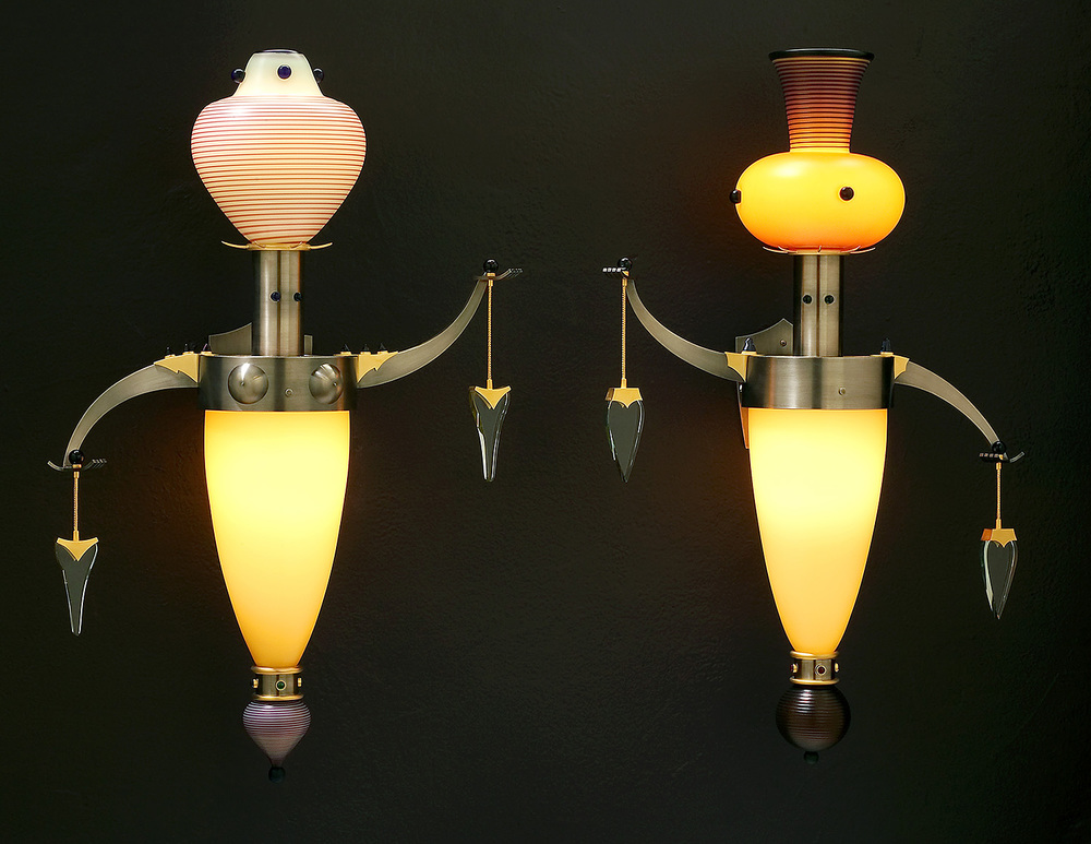 "Attendants   2003. Blown glass, nickel and gold-plated bronze, and lampworked glass. Male: 28 x 15 x 8"" Female: 27 x 15 x 8"""
