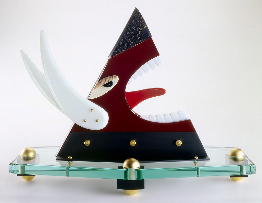 Shooting the Bull   1984. Vitrolite, plate glass, gold-plated bronze. 17 x 15 x 20""