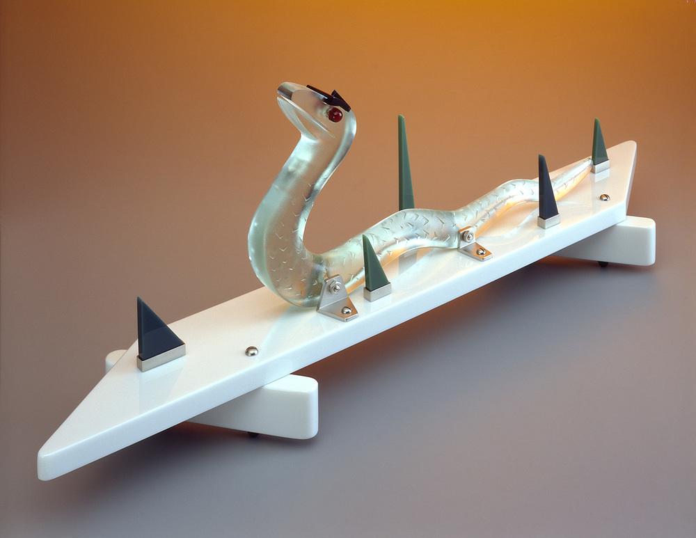 Snake in the Grass   1983. Vitrolite, plate glass, nickel-plated brass.