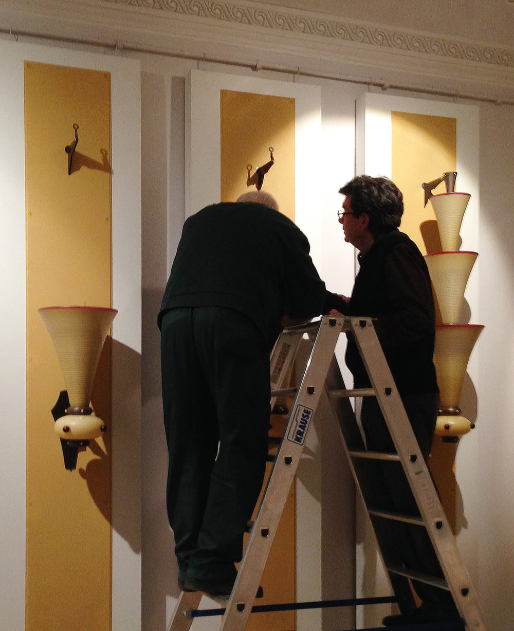 Dailey and a Hermitage Museum electrician install his Byzantine Sconces before the exhibition opening reception.