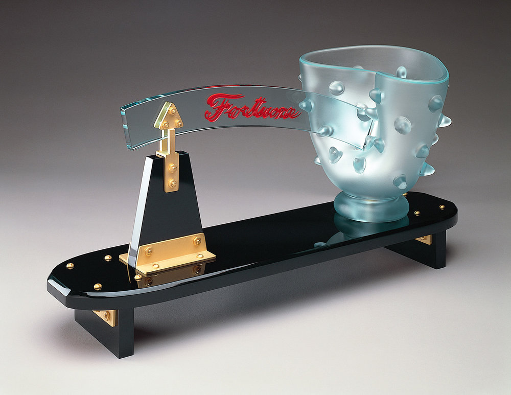 Fortune   1982. Blown glass, plate glass, gold plated brass. 16 x 24 x 8""
