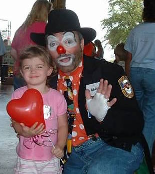 My oldest daughter at 4 years old with a family friend who is a Fire Safety Clown with our local Fire station.