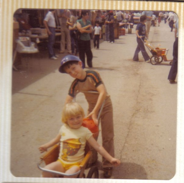 My cousin, Josh, pushing my stroll at the Texas State Fair sometime in the late 70s. That is a really large acorn on my shirt.