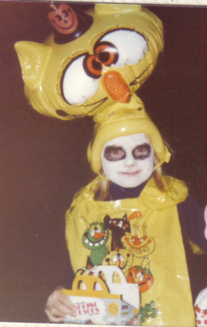 I distinctly remember the blow-up head. I have NO IDEA what this costume is, though. The 80s were a confusing time to be young.