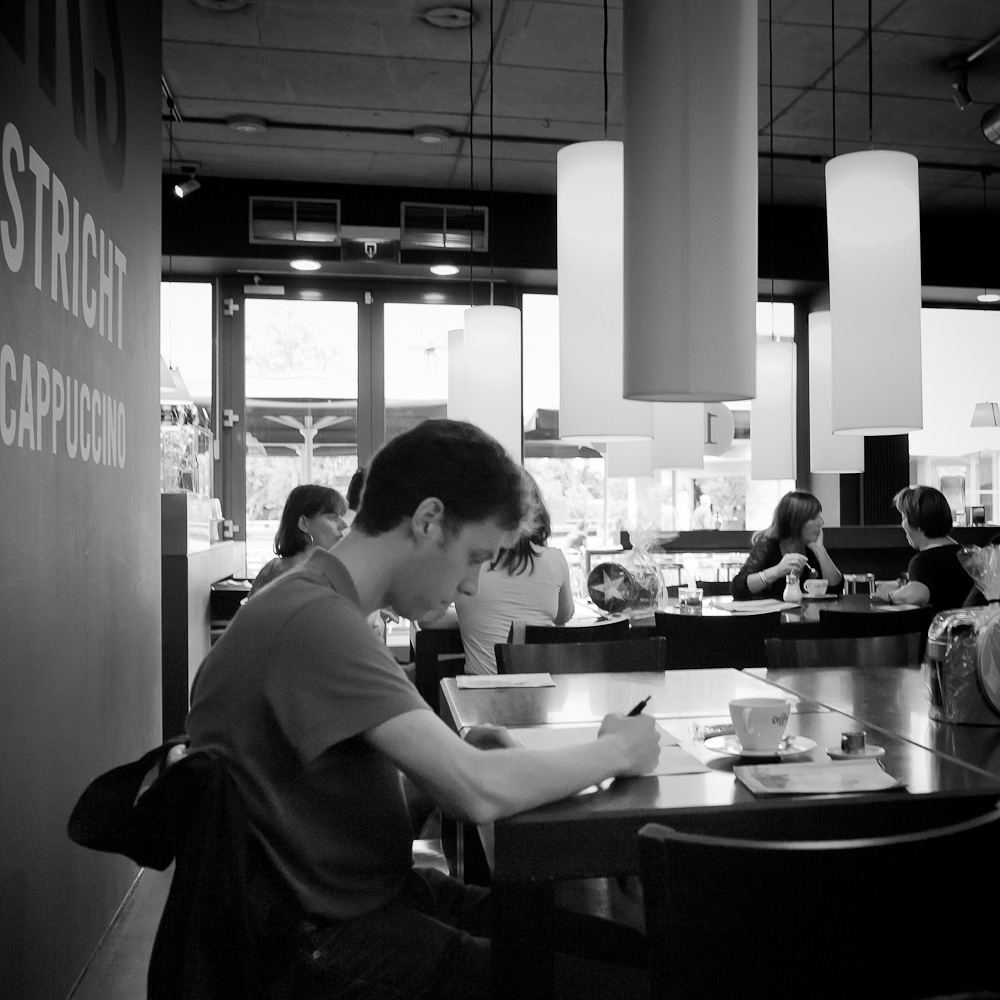 Photo: Student working at Coffeelovers in Maastricht, by Barend Jan de Jong (Leica M9, Summicron 28mm).