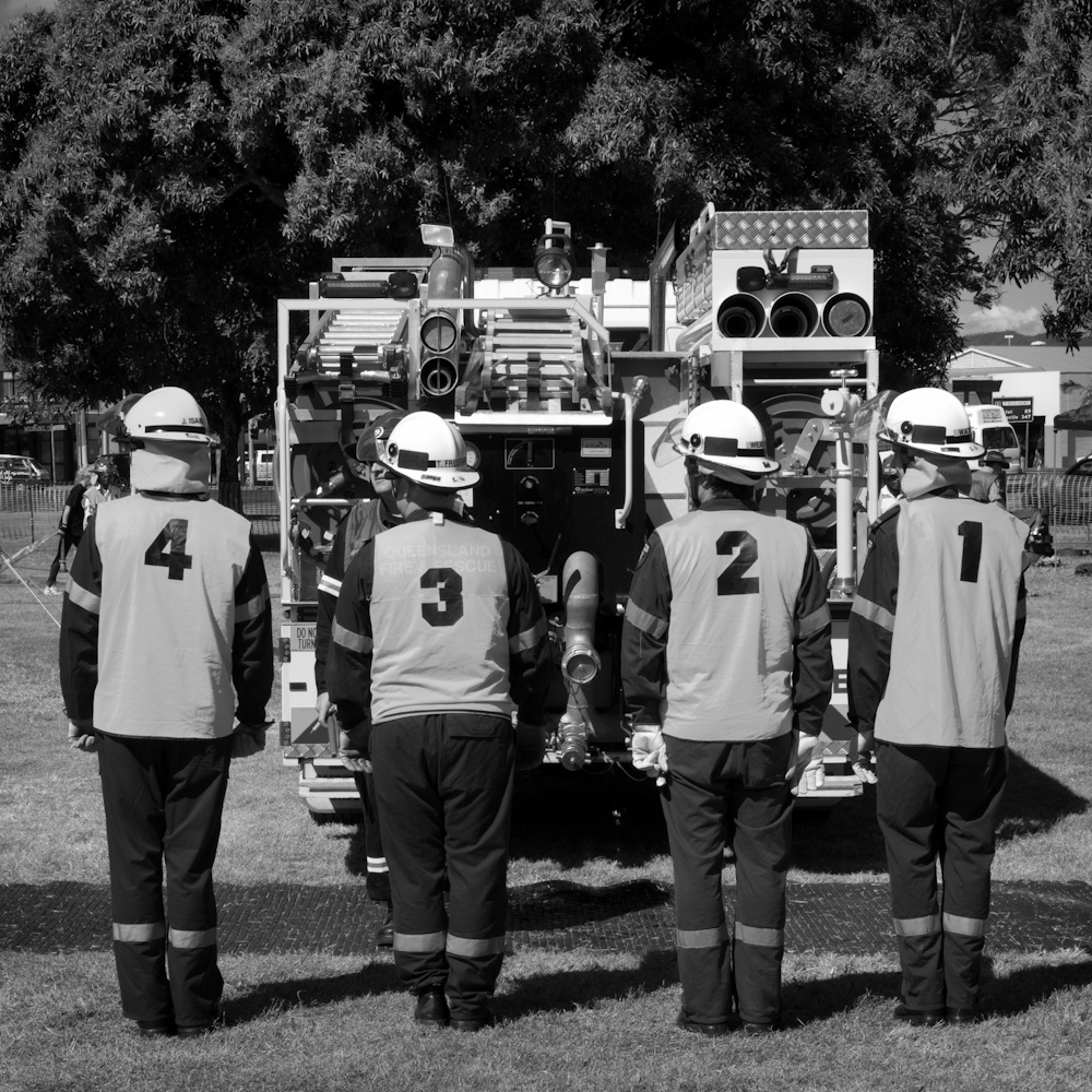 Photo: Four fireman being briefed on their next challenge at the Regional Firefighter Championship (Far Northern Region, Cairns, May 15, 2011), by Barend Jan de Jong (Leica M9, Summicron 50mm).