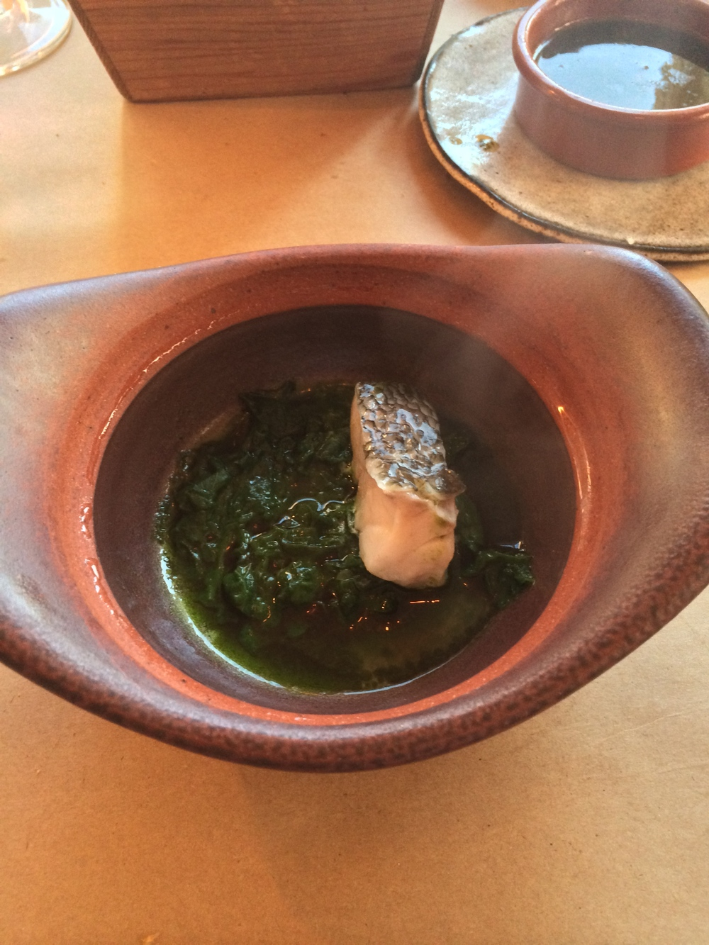 Rockfish steamed in parsley and lovage.