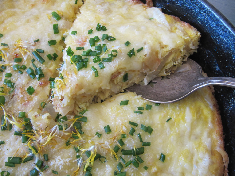 Sauerkraut Frittata garnished with chives and dandelion petals