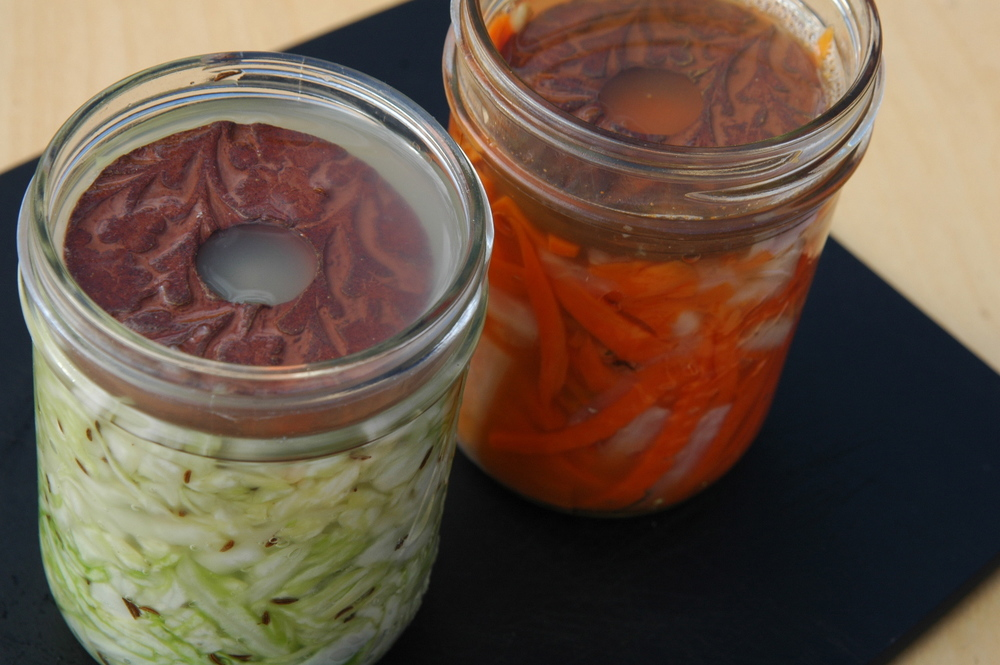 Small batch vegetable fermenting  followers . Note the veggies are submerged! Photo by Josh Ratza.