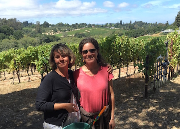 Beautiful day, walking in a vineyard with my bestie—life is good!