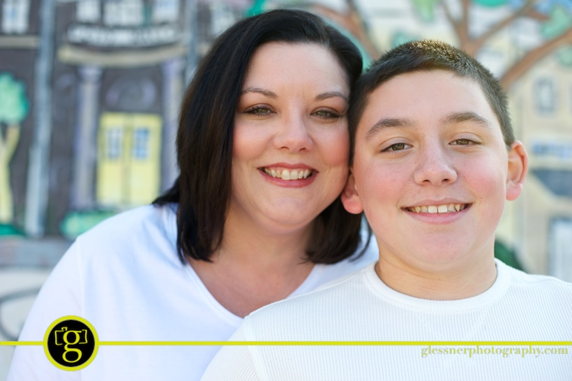 Michelle Cox and Brandon's mother son portraits in downtown Laurel, MS
