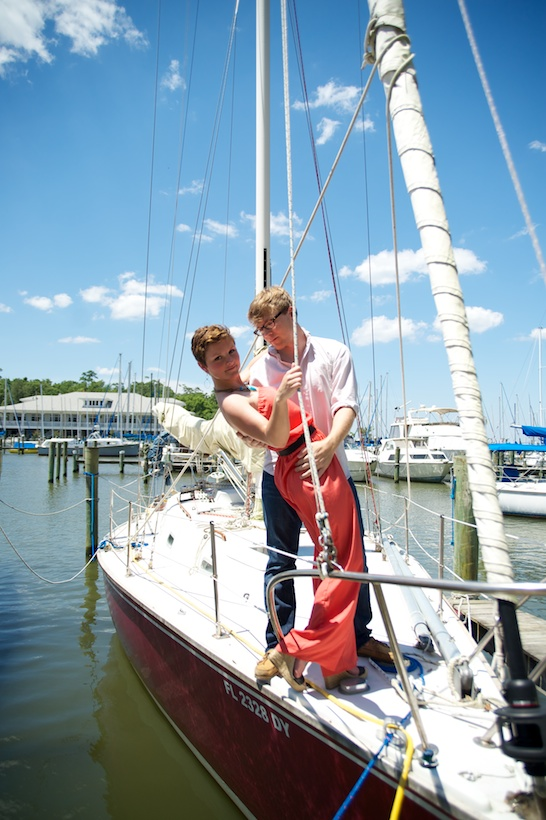Photo by Elizabeth Glessner of Glessner Photography of artist Adam Trest and high school teacher Lily Hedgepeth's sailboat engagement session in Fairhope, AL, as featured on Style Me Pretty