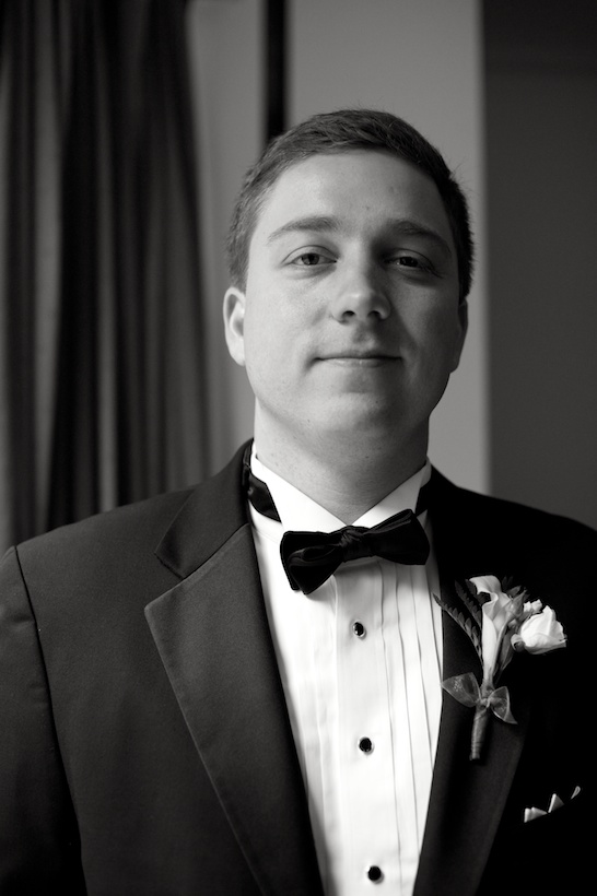 Wedding day groom's portrait by Elizabeth Glessner of Glessner Photography of the groom in Joseph A. Bank at the spring backyard wedding of J.P. Perkins and Katherine Henry in Asheboro, NC