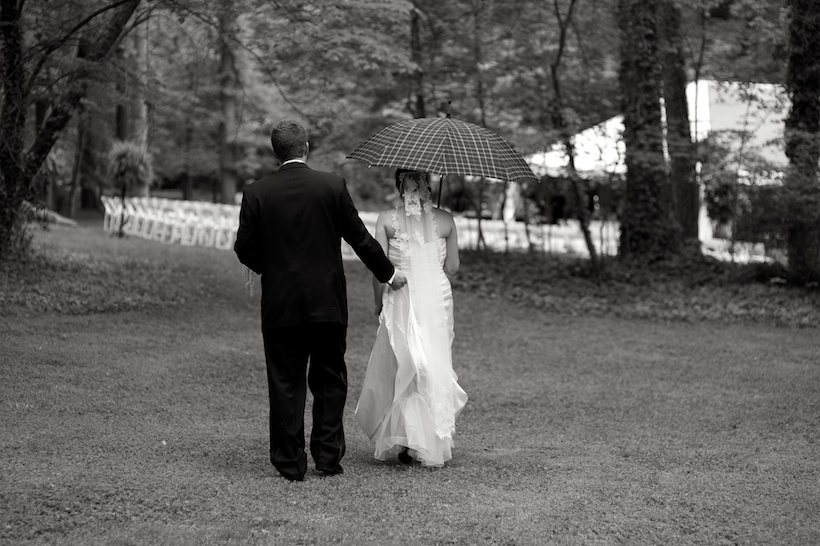 Wedding day photo by Elizabeth Glessner of Glessner Photography of the groom in Joseph A. Bank and the bride wearing a Jenny Lee wedding dress from Carine's Bridal in Washington DC and a vintage cathedral veil with hair and makeup by Carla White of Greensboro at the spring backyard wedding of J.P. Perkins and Katherine Henry in Asheboro, NC