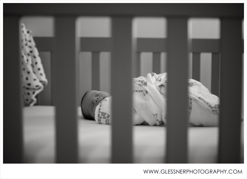 Newborn baby boy in crib photographed by High Point newborn photographer.