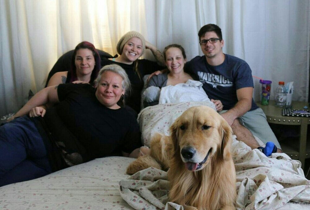 This picture pretty much sums up an epic birth team! Strong mom, supportive dad, awesome doula, amazing midwife, great student midwife, and last but not least... their loving pup! Maverick is a lucky dude.