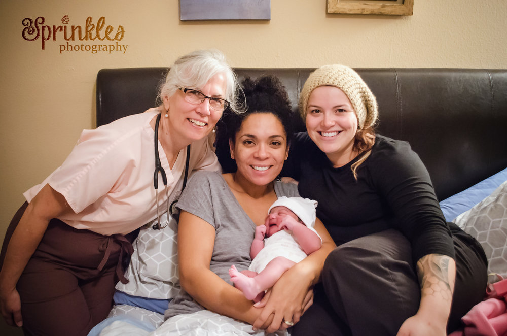 Me and my own trailblazing midwife mama Marianne Power LM, RN and my beautiful client with her fresh new baby after her home birth.