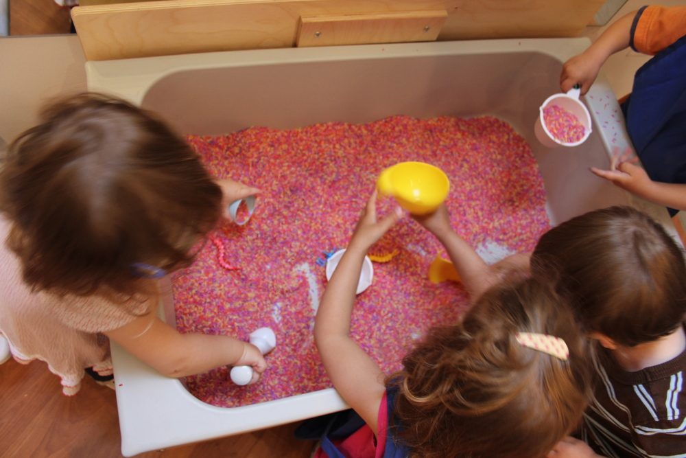 The colored rice sensory bin is the most requested activity at Little Loft.