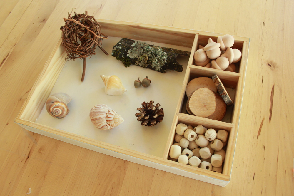 Nature collection boxes can inspire art making and open ended play.