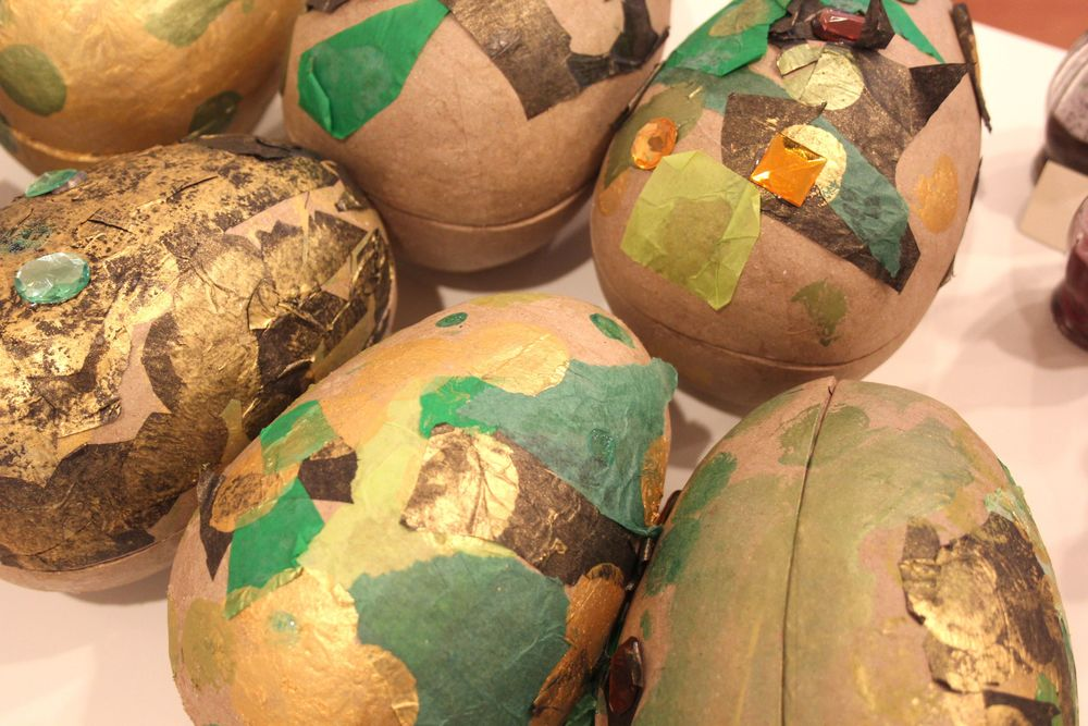 Participants decorated these paper mache dragon  eggs  with tissue, gold paint and jewels. Large plastic Eastereggs and paint markers/metallic sharpies would work for this too.