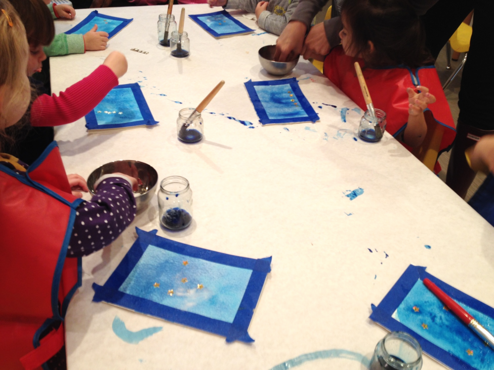Toddler class creating watercolor star sticker resist paintings inspired by  How to Catch a Star,   Oliver Jeffers.