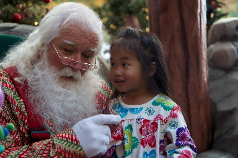 Mia tells Santa her wishes for this year.