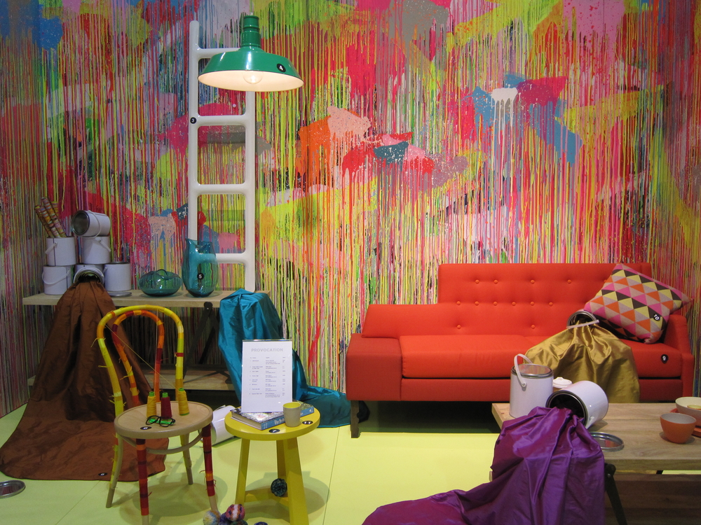 Provocation: A backdrop by  Rowena Martinich  in brights and jewel tones sets the stage for a custom installation.